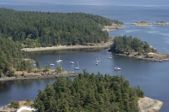 Aerial view looking over Hood Island to the anchorage at Princess Bay on Portland Island, Southern Gulf Islands, British Columbia, Canada.