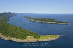 East Point Light station with Tumbo Island in the background, Gulf Islands National Park Reserve of Canada, Saturna Island, British Columbia, Canada.