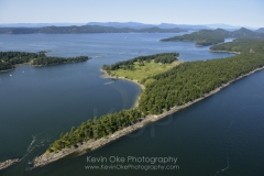 Aerial photo of Samuel Island with Plumper Sound and North Pender Island in the background, British Columbia, Canada.