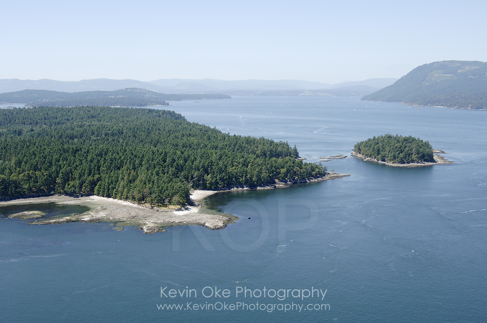 Arbutus Point on Portland Island with Chad Island on the right, Southern Gulf Islands, British Columbia, Canada.