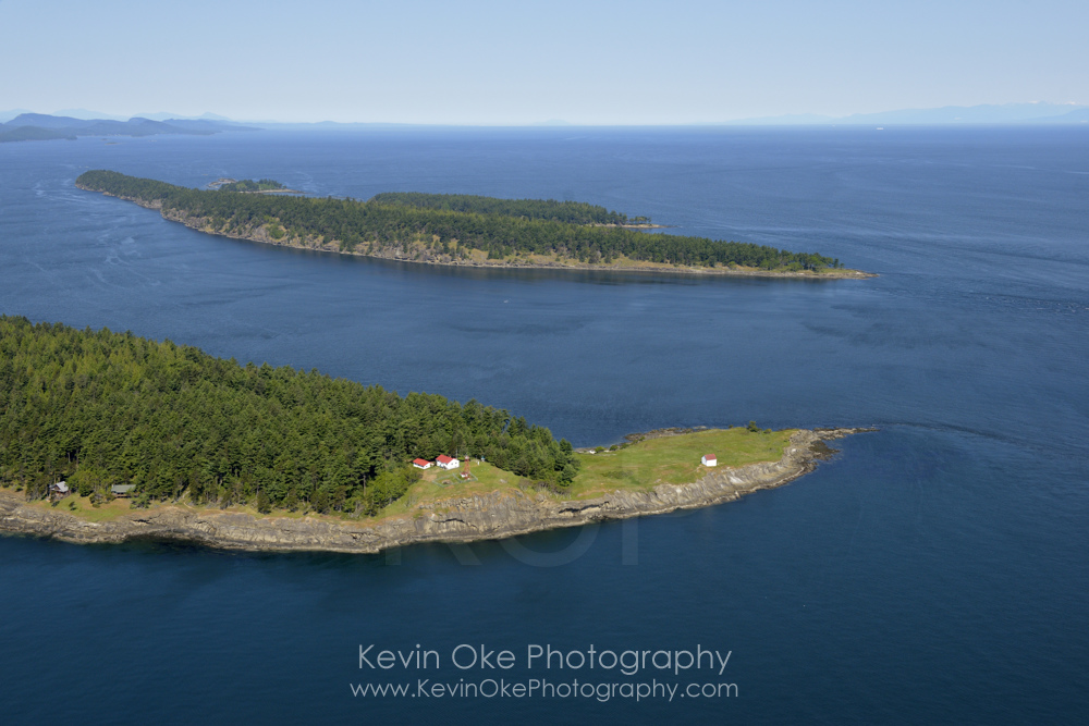 East Point Lightstation and Tumbo Island, Gulf Islands National Park, Saturna Island, British Columbia, Canada.