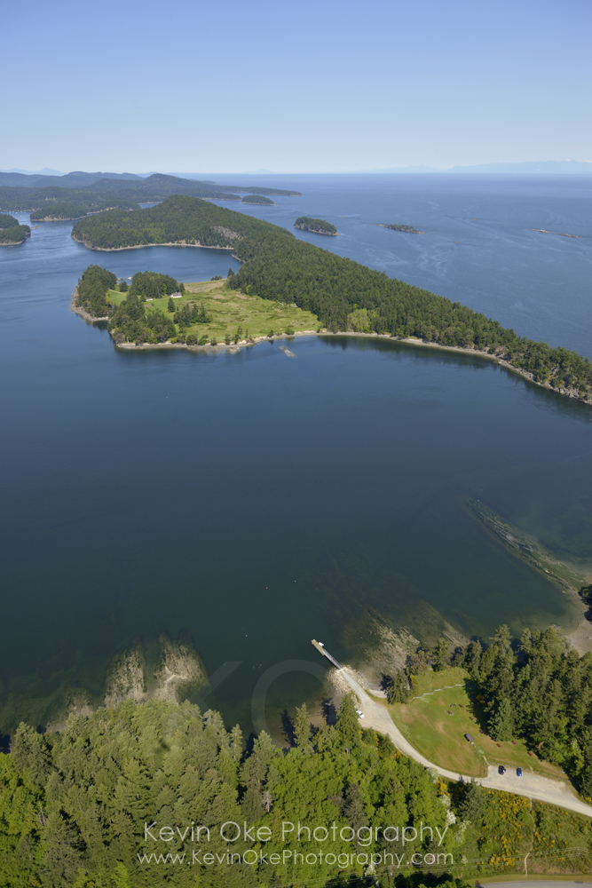 Aerial photo of Winter Cove on Saturna Island with Samuel Island in the background. British Columbia, Canada.