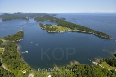 Aerial photograph of Winter Cove on Saturna Island with Samuel Island in the background. British Columbia, Canada.