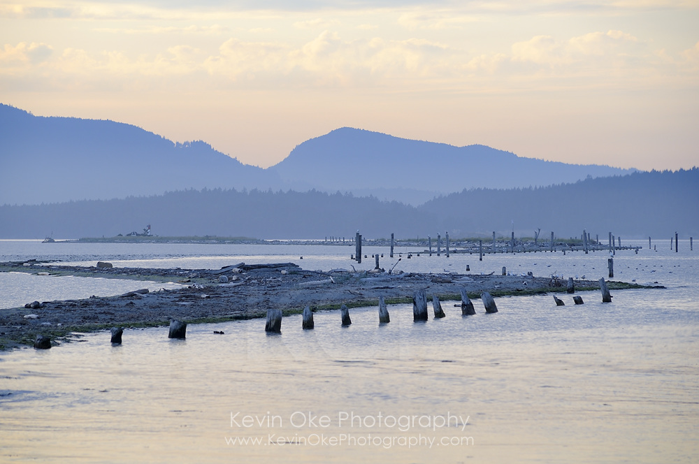 Sidney Spit at sunset with the old pilings, Gulf Islands National Park Reserve of Canada
