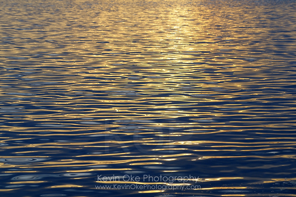 Sunset reflected in gentle waves at Sidney Spit, Gulf Islands National Park Reserve of Canada