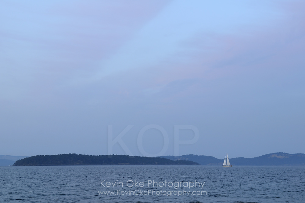 Sailboat approaching the spit from the San Juan Islands, Sidney Spit, Gulf Islands National Park Reserve of Canada