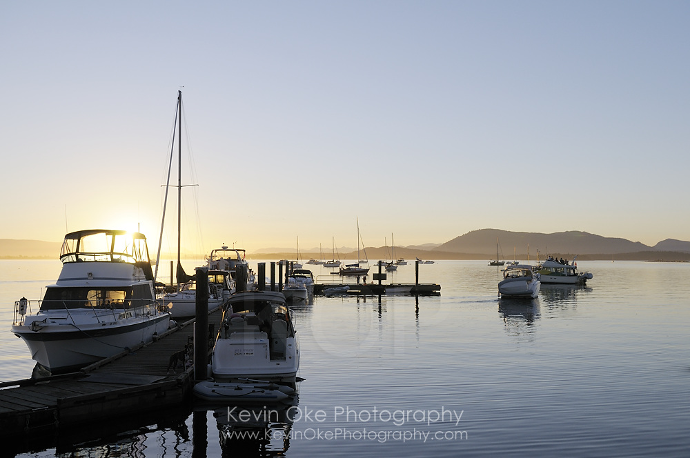 Pleasure boats at the Sidney Spit dock at sunset, Gulf Islands National Park Reserve of Canada