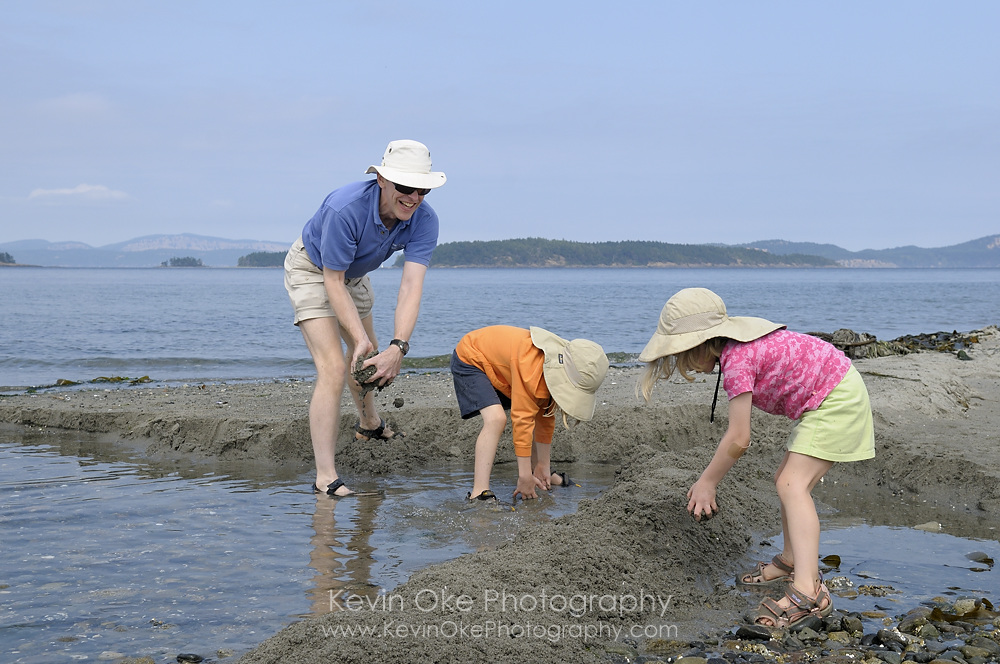 Family playing in the sand on Sidney Spit, Gulf Islands National Park Reserve of Canada