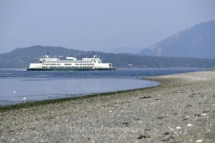 Washington State ferry MV Chelan passing the end of the spit, Sidney Spit, Gulf Islands National Park Reserve of Canada