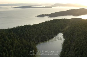 Aerial view of Greenburn Lake, South Pender Island, with North Pender Island and Vancouver Island in the background, South Pender Island