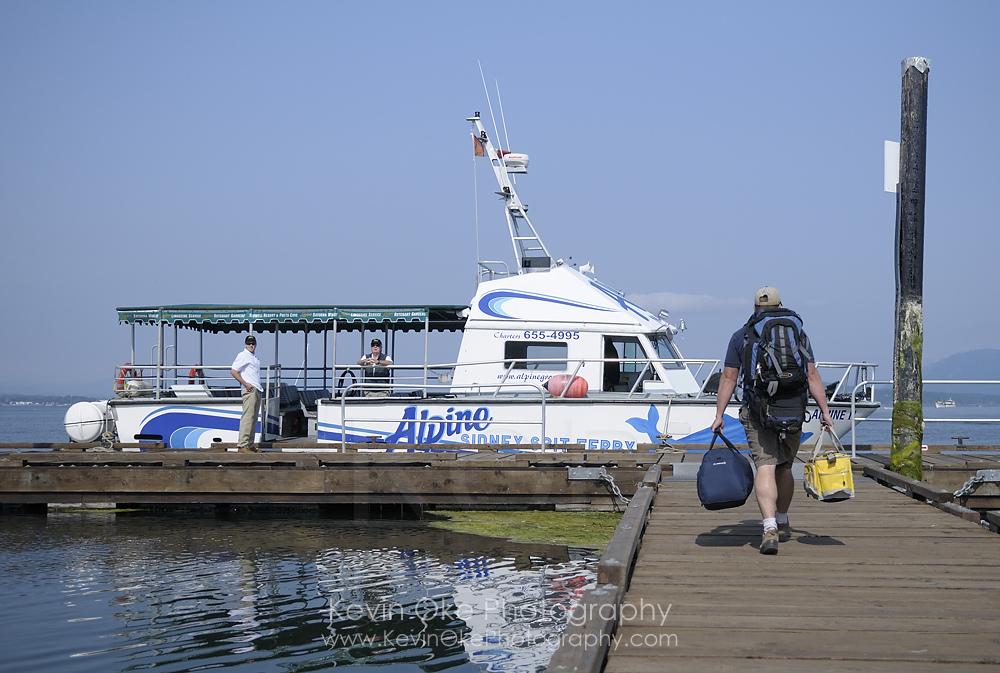 Passenger ferry Alpine II loading passengers, at Sidney Spit, Sidney Island