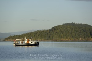 Motorboat cruising through Winter Cove, Saturna Island