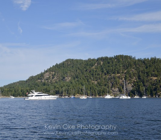 Boats at anchor in front of Mount Norman, South Pender Island