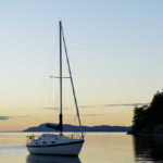 Sailboat at sunset in James Bay, Prevost Island