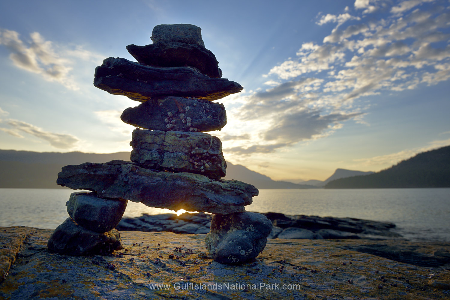 Rock inukshuk in front of Salt Spring Island, Russell Island, British Columbia, Canada