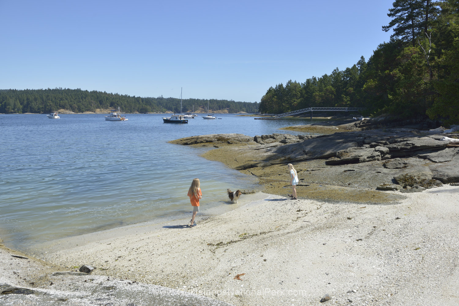 Kids walking on a sandy beach, Russell Island, British Columbia, Canada